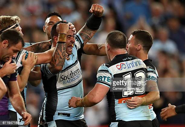Andrew Fifita of the Sharks celebrates with team mates after scoring a try during the 2016 NRL Grand Final match between the Cronulla Sharks and the...