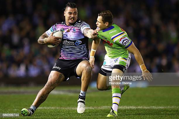 Andrew Fifita of the Sharks fends off Aidan Sezer of the Raiders during the round 22 NRL match between the Cronulla Sharks and the Canberra Raiders...