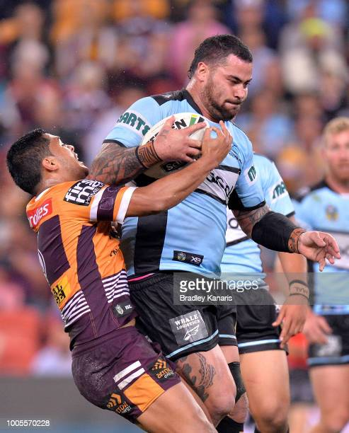 Andrew Fifita of the Sharks is tackled by Anthony Milford of the Broncos during the round 20 NRL match between the Brisbane Broncos and the Cronulla...