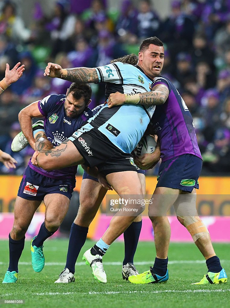 Andrew Fifita of the Sharks is tackled by Cameron Smith of the Storm during the round 26 NRL match between the Melbourne Storm and the Cronulla Sharks at AAMI Park on September 3, 2016 in Melbourne, Australia.