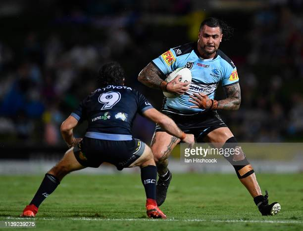 Andrew Fifita of the Sharks is tackled by Jake Granville of the Cowboys during the round three NRL match between the North Queensland Cowboys and the...