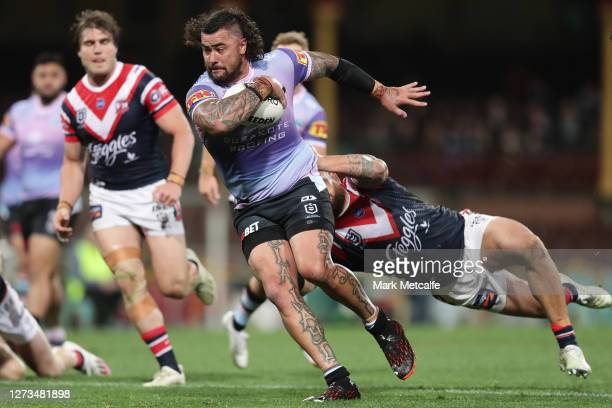 Andrew Fifita of the Sharks Is tackled by Jared Waerea-Hargreaves of the Roosters during the round 19 NRL match between the Sydney Roosters and the...