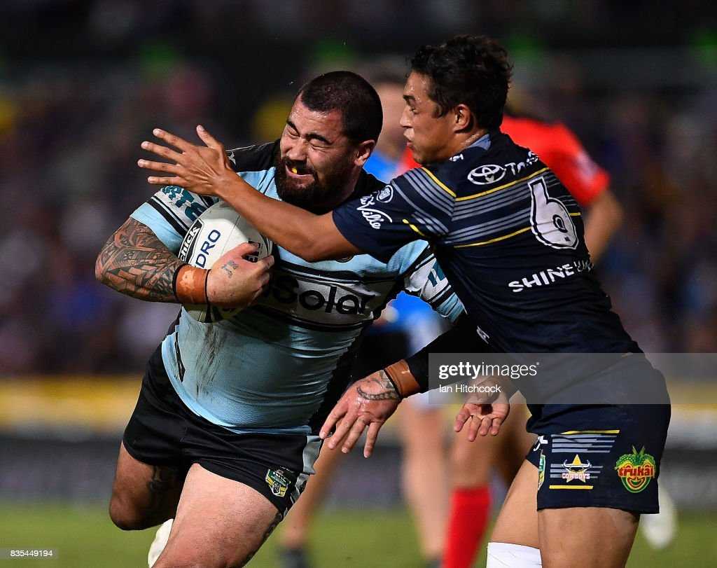 Andrew Fifita of the Sharks is tackled by Te Maire Martin of the Cowboys during the round 24 NRL match between the North Queensland Cowboys and the Cronulla Sharks at 1300SMILES Stadium on August 19, 2017 in Townsville, Australia.