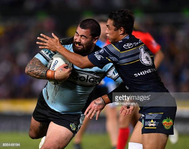 Andrew Fifita of the Sharks is tackled by Te Maire Martin of the Cowboys during the round 24 NRL match between the North Queensland Cowboys and the...