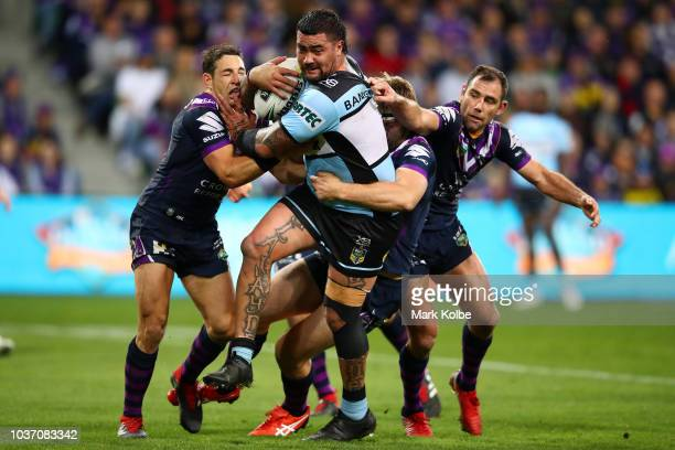 Andrew Fifita of the Sharks is tackled during the NRL Preliminary Final match between the Melbourne Storm and the Cronulla Sharks at AAMI Park on...