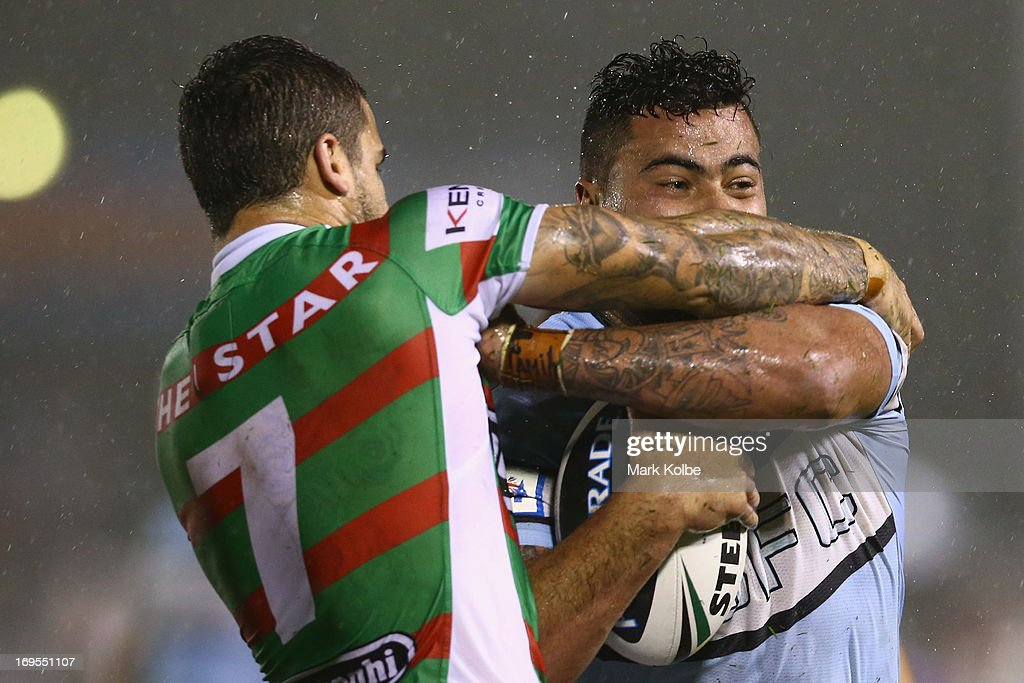 Andrew Fifita of the Sharks is tackled during the round 11 NRL match between the Cronulla Sharks and the South Sydney Rabbitohs at Sharks Stadium on May 27, 2013 in Sydney, Australia.
