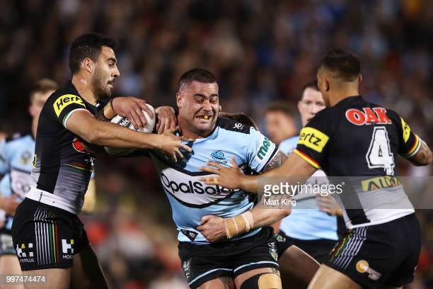 Andrew Fifita of the Sharks is tackled during the round 18 NRL match between the Panthers and the Sharks at Panthers Stadium on July 13 2018 in...
