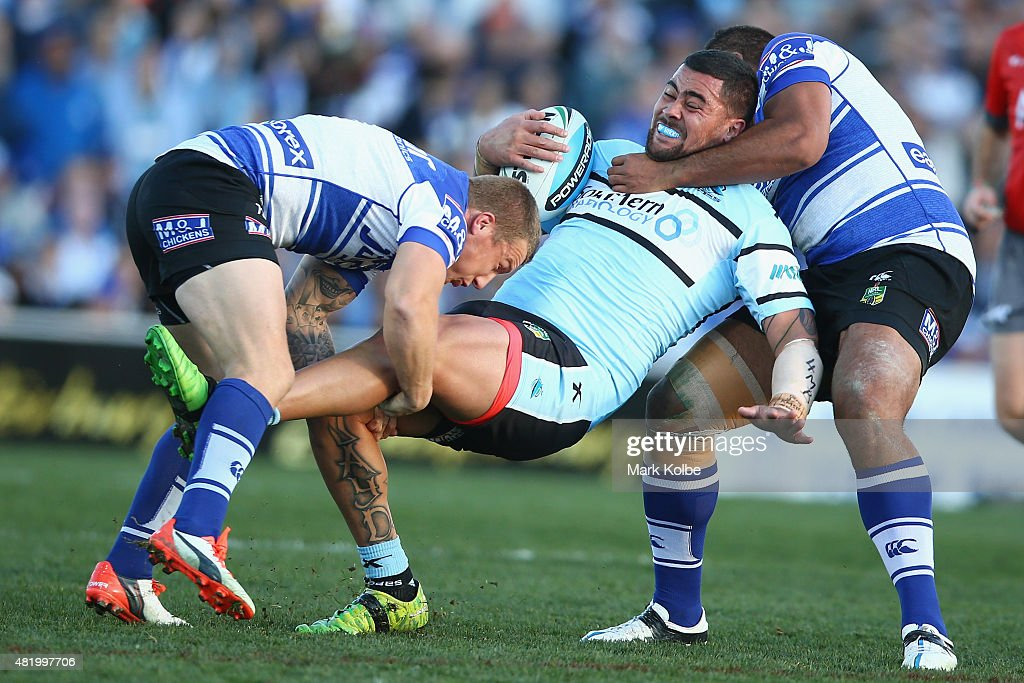 Andrew Fifita of the Sharks is tackled during the round 20 NRL match between the Canterbury Bulldogs and the Cronulla Sharks at Belmore Sports Ground on July 26, 2015 in Sydney, Australia.