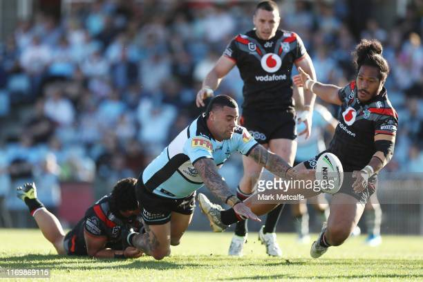 Andrew Fifita of the Sharks Is tackled during the round 23 NRL match between the Cronulla Sharks and the New Zealand Warriors at Shark Park on August...