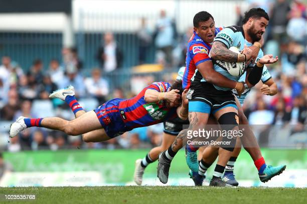 Andrew Fifita of the Sharks is tackled during the round 24 NRL match between the Cronulla Sharks and the Newcastle Knights at Southern Cross Group...