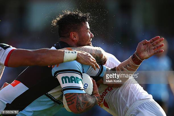 Andrew Fifita of the Sharks is tackled during the round two NRL match between the Cronulla Sharks and the St George Illawarra Dragons at Shark Park...
