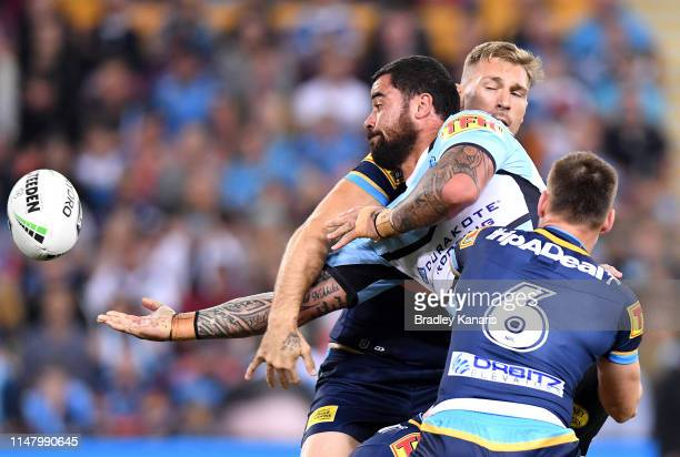 Andrew Fifita of the Sharks offloads during the round nine NRL match between the Gold Coast Titans and the Cronulla Sharks at Suncorp Stadium on May...