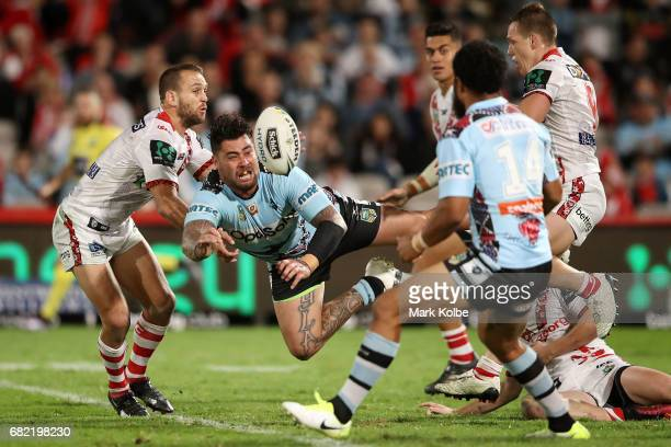 Andrew Fifita of the Sharks passes as he is tackled during the round 10 NRL match between the St George Illawarra Dragons and the Cronulla Sharks at...