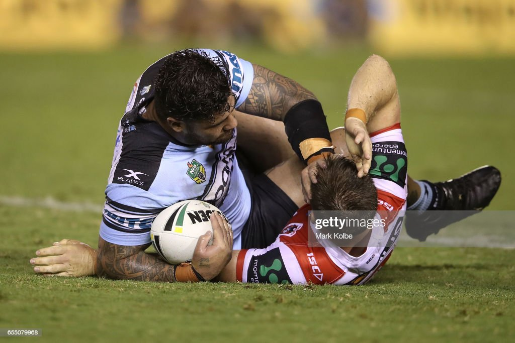 Andrew Fifita of the Sharks pushes away Josh McCrone of the Dragons after being tackled during the round three NRL match between the Cronulla Sharks and the St George Illawarra Dragons at Southern Cross Group Stadium on March 19, 2017 in Sydney, Australia.