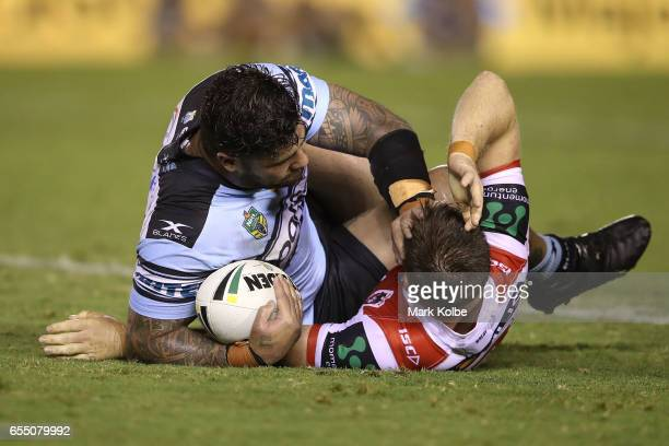 Andrew Fifita of the Sharks pushes away Josh McCrone of the Dragons after being tackled during the round three NRL match between the Cronulla Sharks...