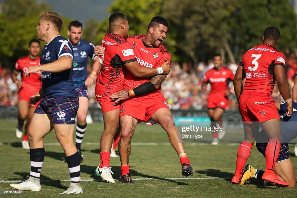 Andrew Fifita of Tonga celebrates a try by Michael Jennings during the 2017 Rugby League World Cup match between Scotland and Tonga at Barlow Park on October 29, 2017 in Cairns, Australia.