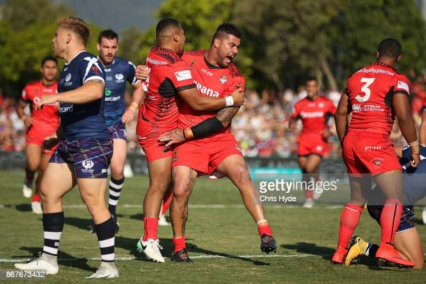 Andrew Fifita of Tonga celebrates a try by Michael Jennings during the 2017 Rugby League World Cup match between Scotland and Tonga at Barlow Park on...
