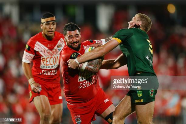 Andrew Fifita of Tonga fends off Tom Trbojevic of Australia during the International Test match between Tonga and Australia at Mount Smart Stadium on...