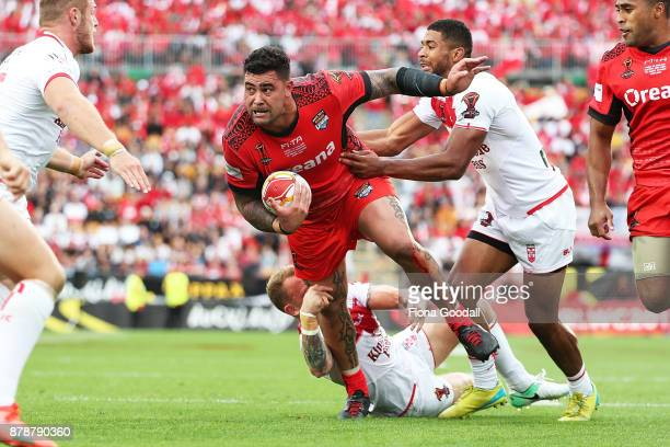 Andrew Fifita of Tonga heads for the try line under pressure during the 2017 Rugby League World Cup Semi Final match between Tonga and England at Mt...