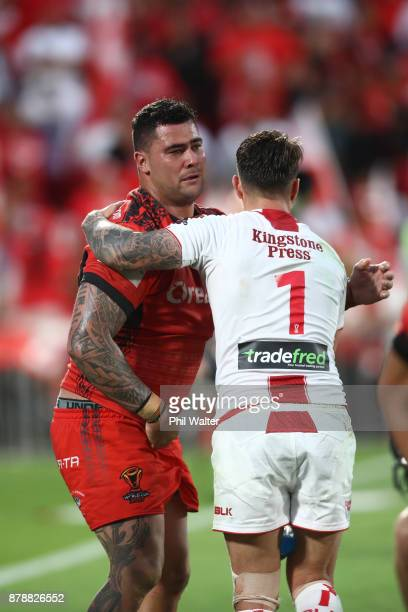 Andrew Fifita of Tonga is consoled by Gareth Widdop of England following the 2017 Rugby League World Cup Semi Final match between Tonga and England...