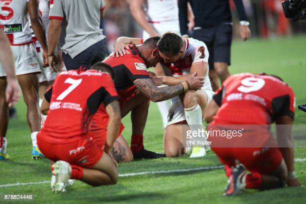 Andrew Fifita of Tonga is consoled following the 2017 Rugby League World Cup Semi Final match between Tonga and England at Mt Smart Stadium on...