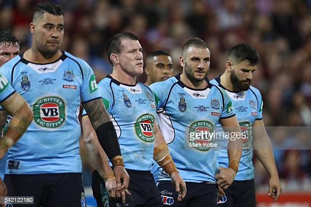 Andrew Fifita Paul Gallen Robbie Farah and Josh Mansour of the Blues look dejected after a try during game two of the State Of Origin series between...