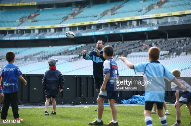 Andrew Fifita takes part in a junior coaching clinic during the New South Wales Blues Team Announcement at ANZ Stadium on July 3 2017 in Sydney...
