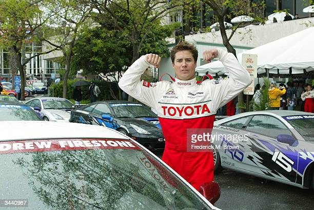 Andrew Firestone shows his muscles at the Pro/Celebrity race of the 30th Annual Toyota Grand Prix of Long Beach April 17 2004 in Long Beach California