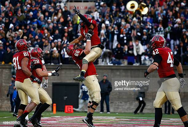 Andrew Fischer of the Harvard Crimson is lifted in the air by teammate Michael Mancinelli following Fischer's gamewinning touchdown in the fourth...