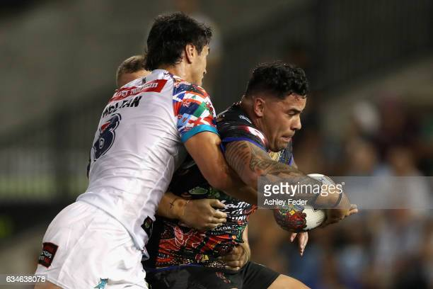 Andrew Fitita of Indigenous All Stars is tackled by World All Stars defence during the NRL All Stars match between the 2017 Harvey Norman All Stars...