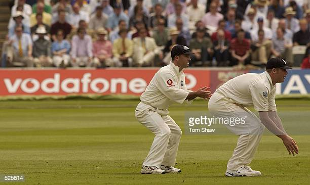 Andrew Flintoff and Graham Thorpe of England during the second day of the first Test Match between England and Sri Lanka at Lord's in London on May...