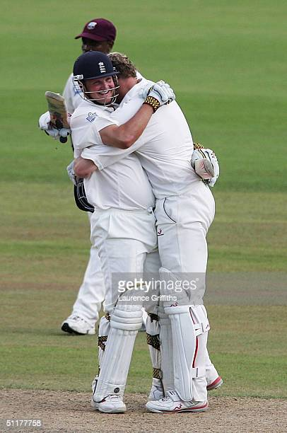 Andrew Flintoff and Robert Key of England celebrate victory during day five of the England v West Indies Third npower Test Match at Old Trafford on...