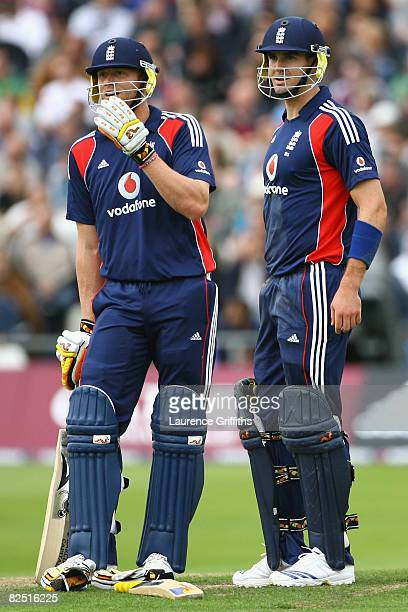 Andrew Flintoff and team mate Kevin Pietersen of England await the decision on a run out during the First NatWest Series One Day International match...