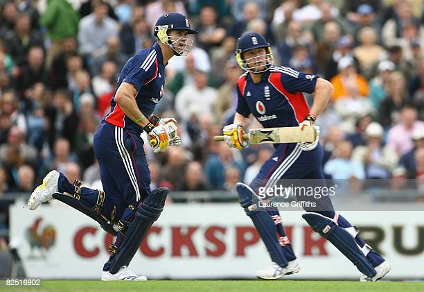 Andrew Flintoff and team mate Kevin Pietersen of England get some runs during the First NatWest Series One Day International match between England...