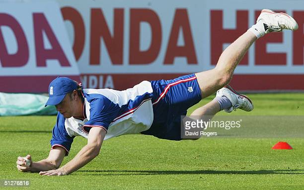 Andrew Flintoff dives to catch the ball during the England nets session at Edgbaston Cricket Ground on September 9 2004 in Birmingham England