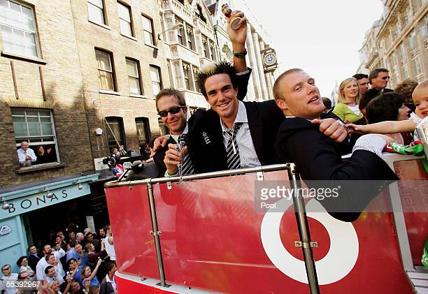 Andrew Flintoff Kevin Peiterson and captain Michael Vaughn pose for a photograph aboard the parade bus on the way to Trafalgar Square as part of the...