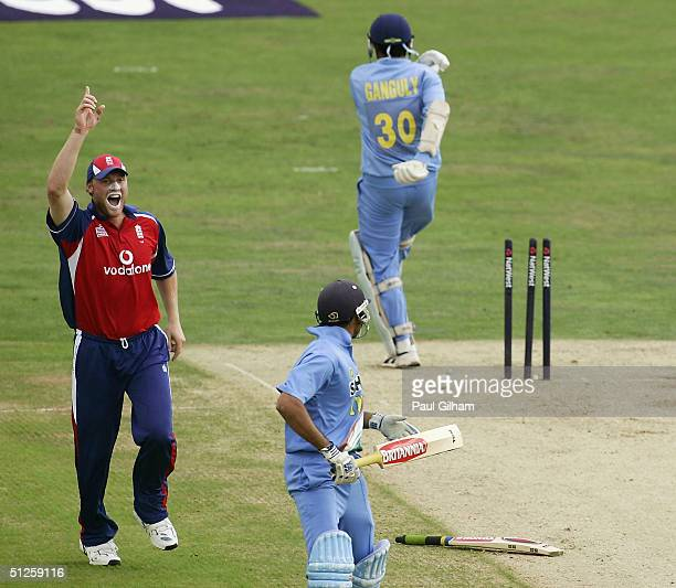 Andrew Flintoff of England celebrates running out Sourav Ganguly of India as his team-mate VVS Laxman looks back during the Natwest Challenge match...