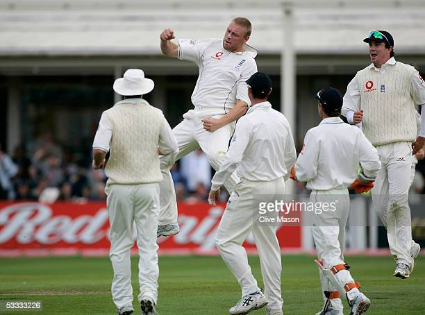Andrew Flintoff of England celebrates taking the wicket of Justin Langer of Australia during day three of the second npower Ashes Test match between...