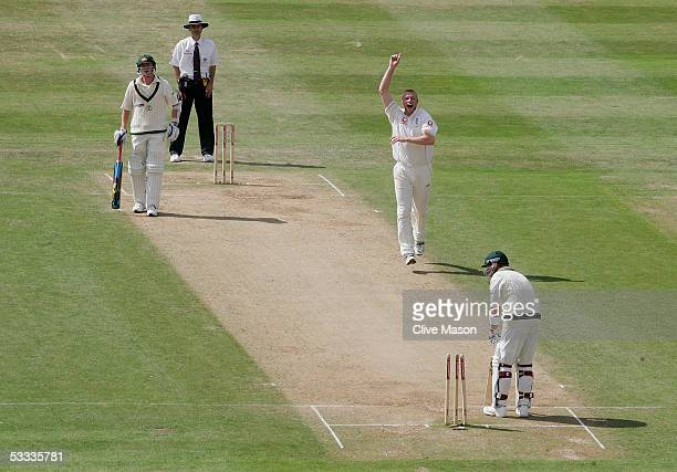 Andrew Flintoff of England celebrates taking the wicket of Shane Warne of Australia during day four of the second npower Ashes Test match between...