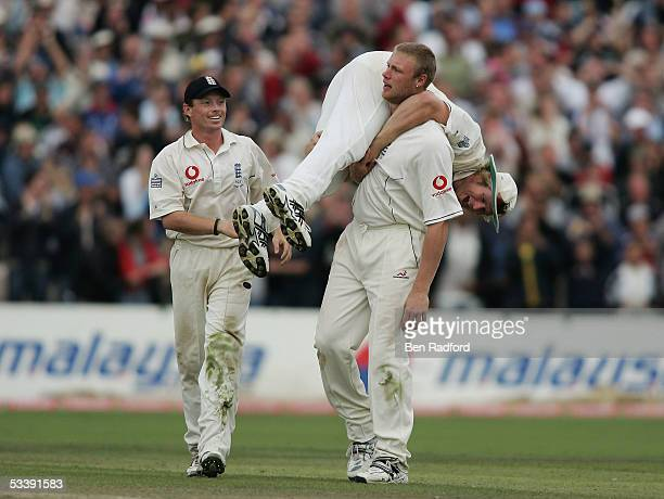 Andrew Flintoff of England celebrates with Matthew Hoggard after taking the wicket of Shane Warne of Australia during day five of the third npower...