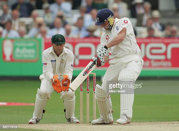 Andrew Flintoff of England edges his shot to Adam Gilchrist and is caught out off the bowling of Shane Warne during day three of the first npower...