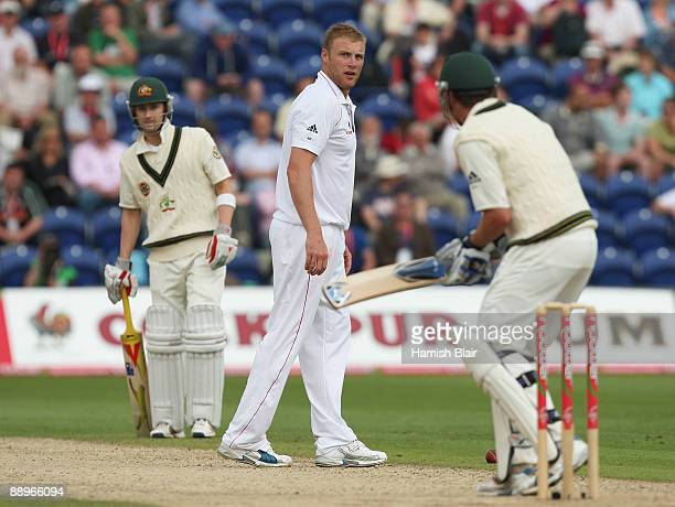 Andrew Flintoff of England exchanges words with Marcus North of Australia during day three of the npower 1st Ashes Test Match between England and...
