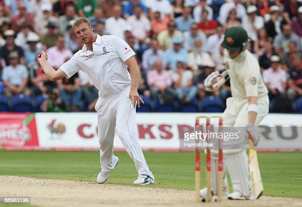 Andrew Flintoff of England fields a shot from Michael Clarke of Australia during day three of the npower 1st Ashes Test Match between England and...