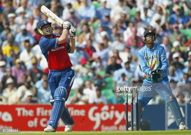 Andrew Flintoff of England hits a six during the Natwest Challenge match against India at the Oval on September 3 2004 in London, England.