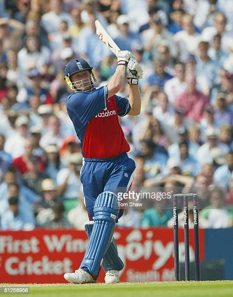 Andrew Flintoff of England hits a six during the NatWest Challenge match between England and India at the Brit Oval on September 3 2004 in London,...