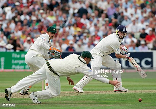 Andrew Flintoff of England hits out as Matthew Hayden of Australia dives in vain during day one of the Second npower Ashes Test match between England...