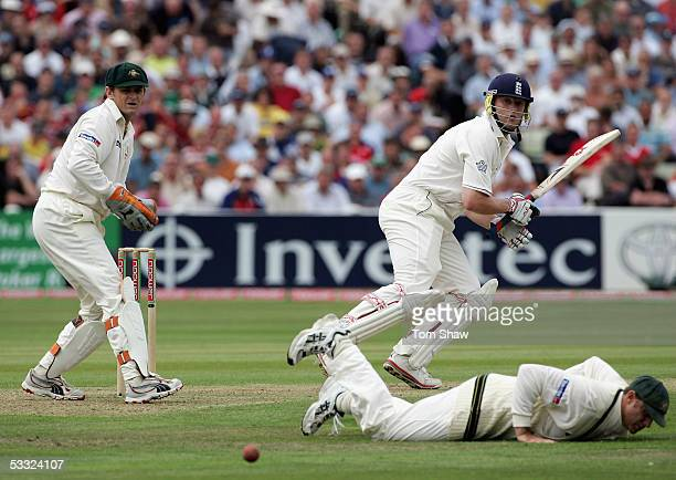Andrew Flintoff of England hits out as Matthew Hayden of Australia fails to stop the ball during day one of the Second npower Ashes Test match...