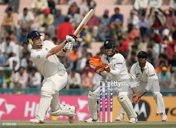 Andrew Flintoff of England hits out during day five of the Second Test Match between India and England at the Punjab Cricket Association Ground on...