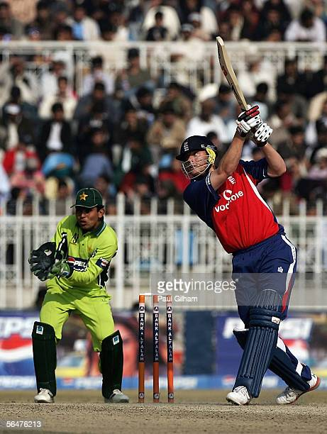 Andrew Flintoff of England hits out during the fifth one day international match between Pakistan and England at The Rawalpindi Cricket Stadium on...