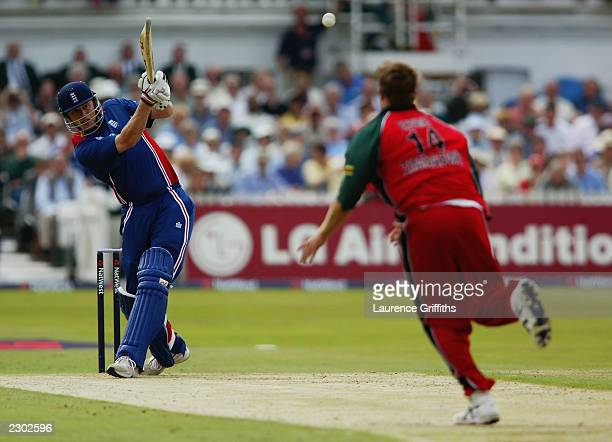 Andrew Flintoff of England hits out during the first match of the NatWest One Day Triangular Series between England and Zimbabwe on June 26 2003 at...